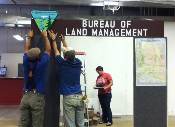 Darrin and Dan hang up the BLM sign they and Tyler painted earlier in the morning.