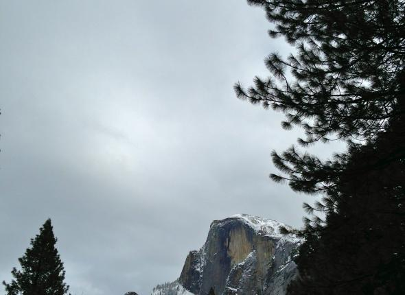 Snow capped Half Dome on a dreary morning in Yosemite Valley.