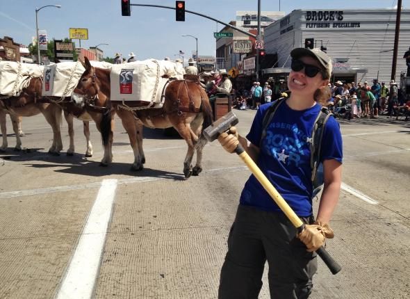 Jen decided to carry the heaviest tool we have down main street for the Mule Days parade