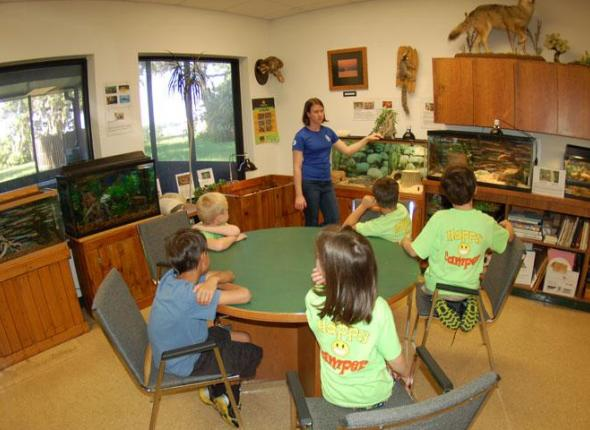 SCA Intern Jennifer Bright teaches conservation to children at the Jacksonville Naval Base