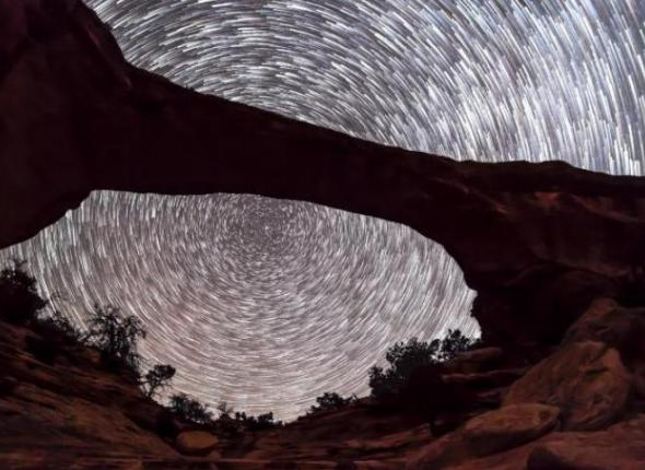 This long exposure shows stars streaking across the night sky at International Dark Sky certified park Natural Bridges National Monument.