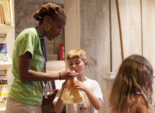SCA Junior Ranger Intern Aurelia Casey works with children near Rock Creek Park, Washington DC