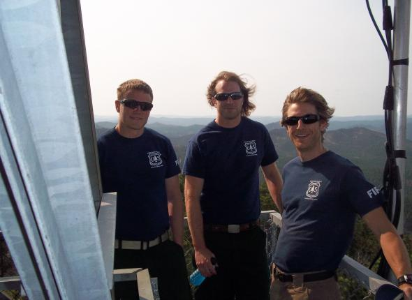 Corps membes and project leader atop Seth lookout tower