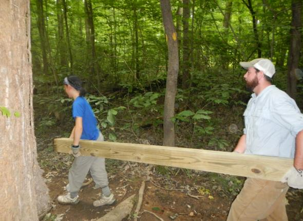 Ada and Michael leading the way to begin building the boardwalk