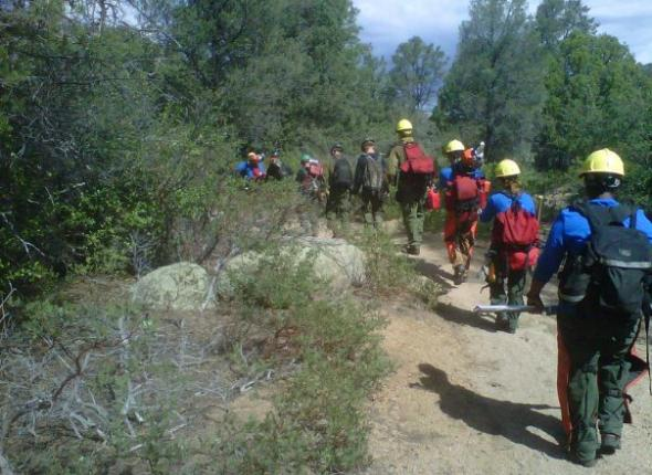 The VFC hikes into the field with Prescott National Forest's fire fighters.