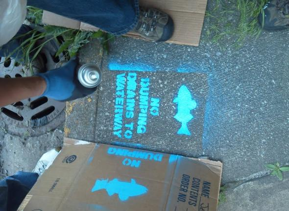 Storm drain stenciling in Miller Beach