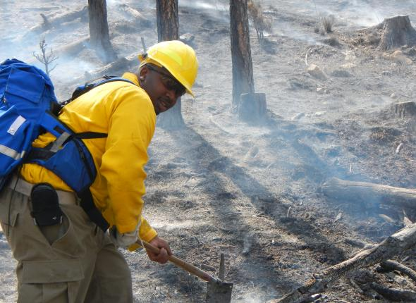 SCA Corps Member, Davon Goodwin, mopping up during a live prescribed burn field training exercise