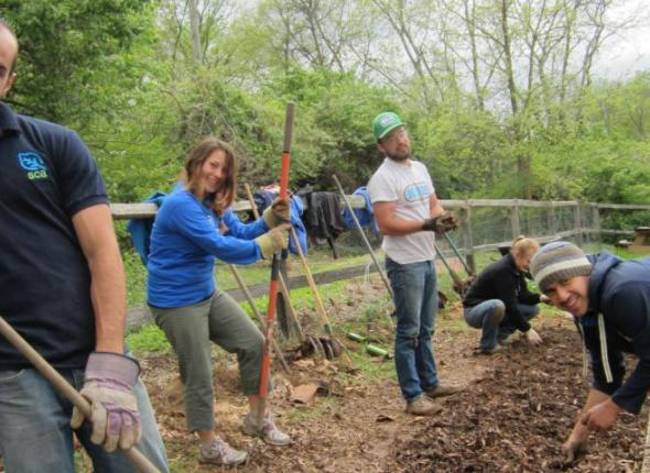 ATL and Nashville ACE teams dig into the soon-to-be cucumber garden bed. Left to right: Michael, Eva, Clayton, Mike