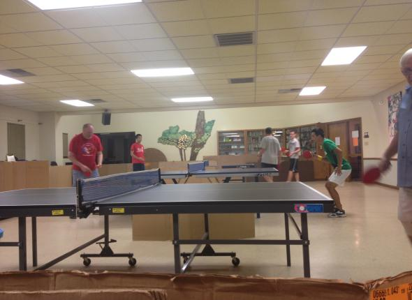 Taylor showing off his table tennis skills