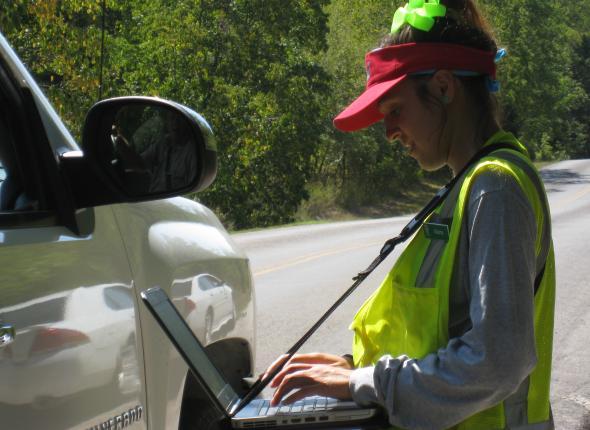 Alaina in surveying action.
