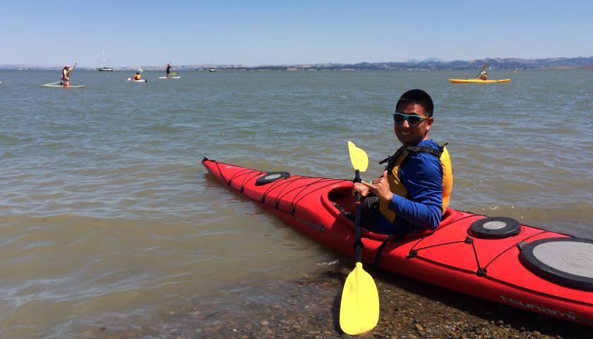 SCA Centennial Volunteer Ambassador, Yin Gao, ready for a kayak adventure
