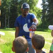 SCA Member William Moore III working with kids at Kenai National Wildlife Refuge